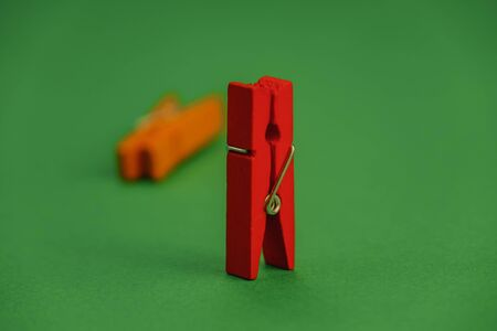 plastic clothespins on a green background