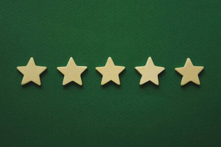 five white stars on a green background.