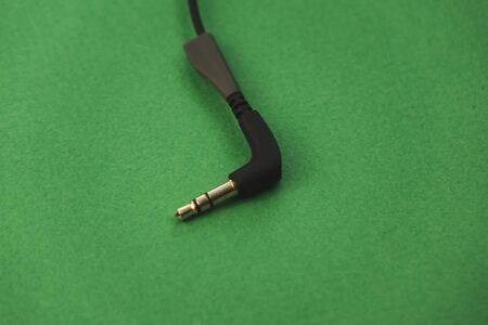 black headphone on green background. Standard-Bild