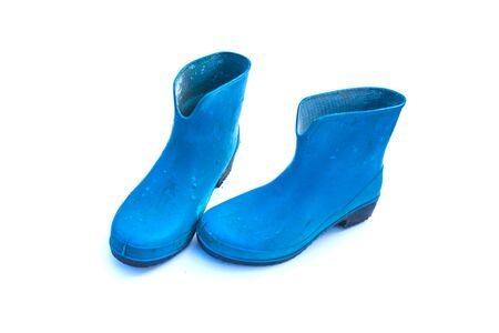 blue rubber waterproof boots on white background