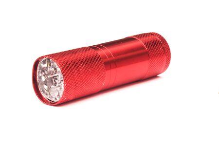 red plastic flashlight isolated on white background