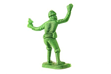 miniature toy soldier on white background, close-up.