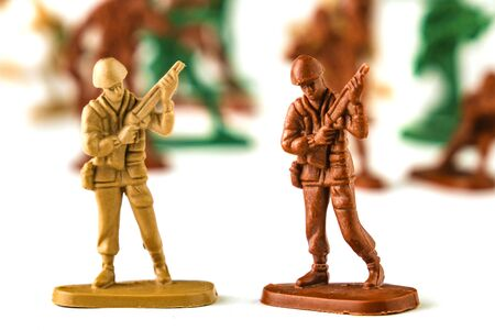 army of toy soldiers isolated white background