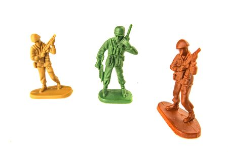 miniature toy soldiers isolated on white background