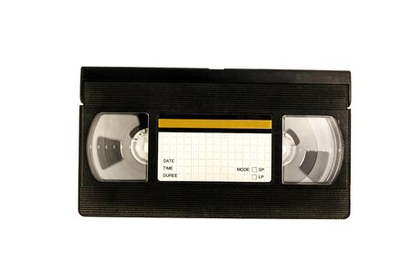 Large picture of an old Video Cassette tape on white background. Stock Photo