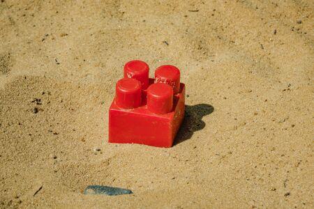 part of the children's designer red lying on the sand Stock fotó