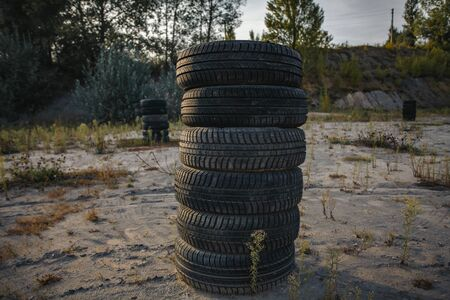 a bunch of old rubber tires lying on top of each other.