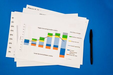 Stack of documents and charts isolated on blue background Stock fotó