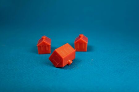 red miniature three houses. the concept of wealth, influence, environment, success