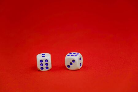 two white dice on a red background Stockfoto