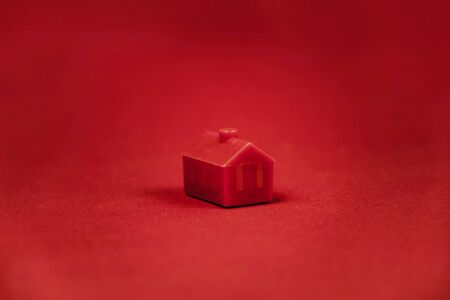 red miniature house isolated on red background Stok Fotoğraf