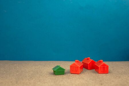 red and green miniature houses, the concept of wealth, success, fame, beautiful life Stok Fotoğraf