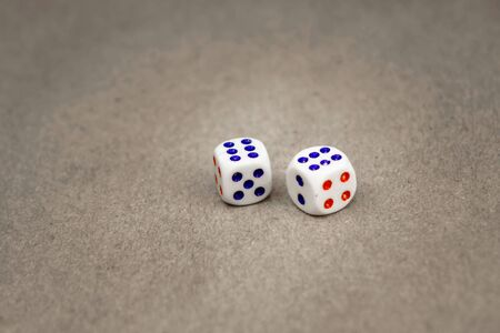 two white dice isolated on a grey background