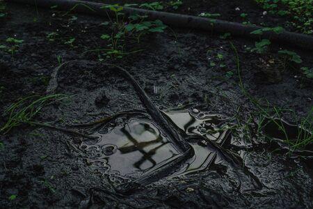 Soil Background mud puddle marsh well blue sky rice. Banco de Imagens