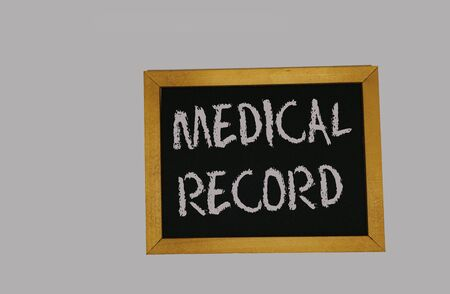 a sign lying on a gray background with the inscription medical record Stock Photo