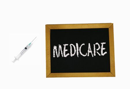 sign lying on a white background in the form of a template  pattern with the inscription medicare Banco de Imagens