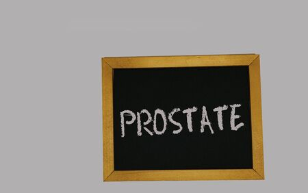 a sign lying on a gray background with the inscription prostate