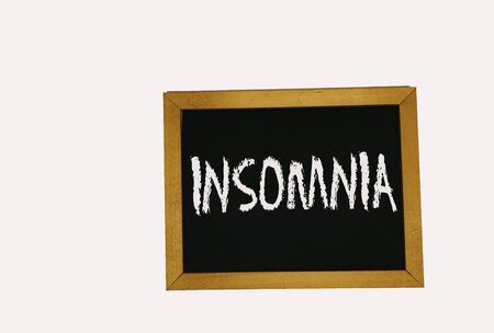 sign lying on a white background in the form of a template  pattern with the inscription insomnia Banco de Imagens