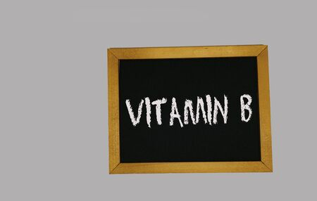 a sign lying on a gray background with the inscription vitamin B Stock Photo
