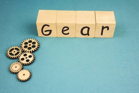 wooden mechanisms, with the inscription gear on a blue background.