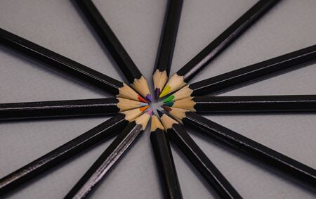 multicolored pencils folded rods to each other.