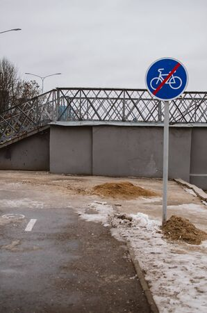 blue sign meaning the end of the bike path