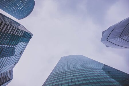three glass skyscrapers. bottom view of the sky