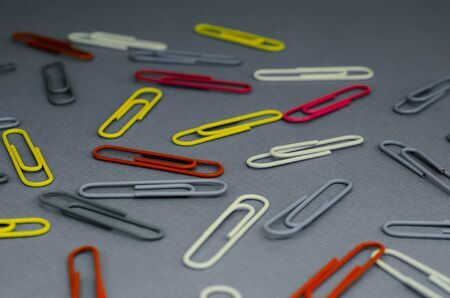 multicolored paperclips on a black and white background