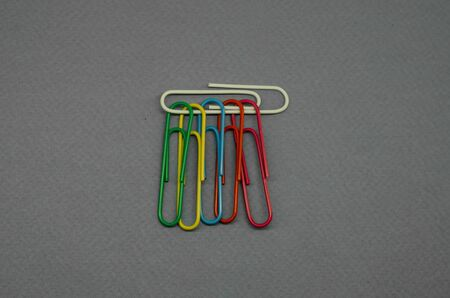 black white background and colored paper clips