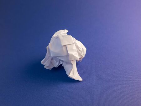 Crumpled white paper on a blue seamless background