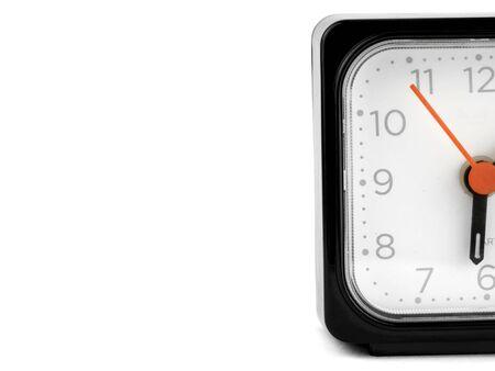 protruding half black alarm clock on a white background.
