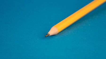front part yellow pencil on a blue background
