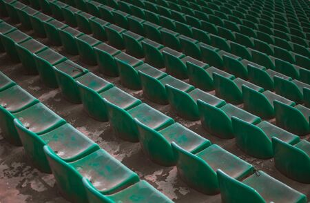 perspective from the sector of green seats in the tribunes of the stadium. Stock Photo