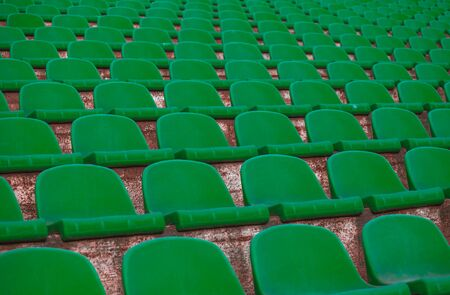 rows of green tribunes in a huge stadium. 版權商用圖片 - 143518317