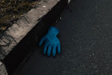 Discarded lying on the floor blue disposable gloves medical. Coronavirus COVID-19 Infection control concept