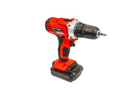 red electric drill isolated on white background. Zdjęcie Seryjne
