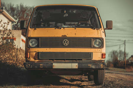Russia Moscow April 27, 2020. an old rusty Volkswagen trasporter in orange