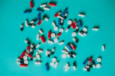 a bunch of colorful pills on a blue background.