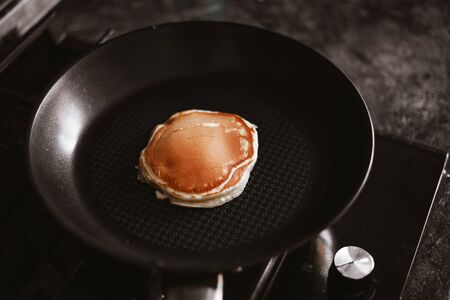 one delicious pancake is cooked in a pan. 스톡 콘텐츠