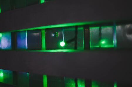 so many green lanterns on the wall at night.