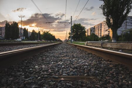 rails for trains at sunset in the city center