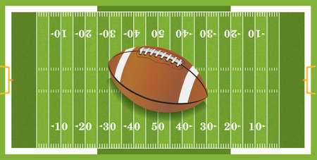 A football sitting at midfield of a grass textured football field