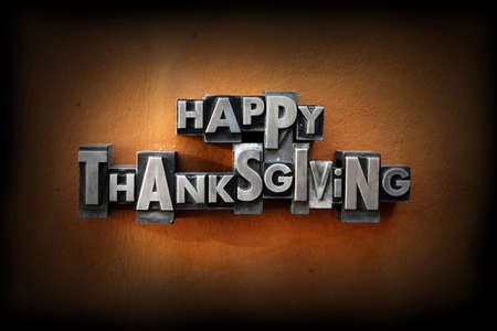 thanksgiving greeting: The words Happy Thanksgiving made from vintage lead letterpress type on a leather background.