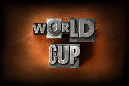 The words World Cup made from vintage lead letterpress type on a leather background. photo