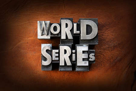 baseball game: The words World Series made from vintage lead letterpress type on a leather background.