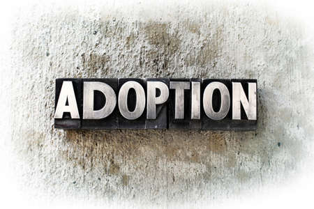 The word ADOPTION written in old vintage letterpress type. photo