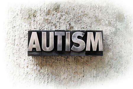 The word AUTISM written in old vintage letterpress type. photo