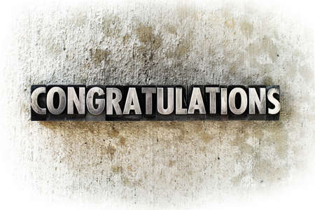 The word CONGRATULATIONS written in old vintage letterpress type. Stock Photo