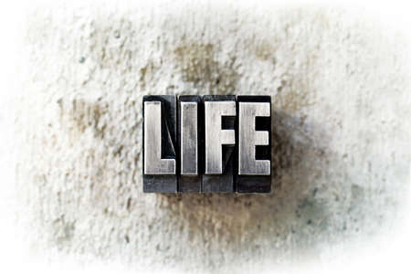 The word LIFE written in old vintage letterpress type. photo