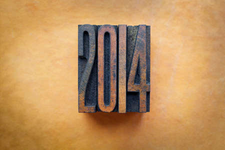 The year 2014 written in vintage letterpress letters.